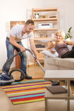 Handsome man using vacuum cleaner at home Royalty Free Stock Photography