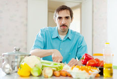 Handsome  man with vegetables in  home Royalty Free Stock Photo