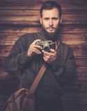 Handsome man with vintage camera Royalty Free Stock Photo