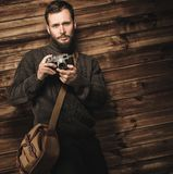 Handsome man with vintage camera Royalty Free Stock Image