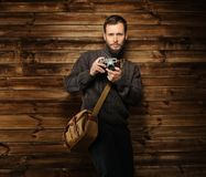 Handsome man with vintage camera Royalty Free Stock Photos