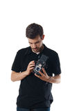 Handsome man with vintage photo camera Royalty Free Stock Photo