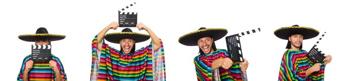 Handsome man in vivid poncho holding clapperboard isolated on wh. Ite Stock Photography