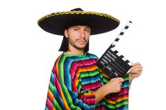Handsome man in vivid poncho holding clapperboard Royalty Free Stock Images
