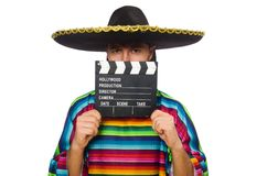 Handsome man in vivid poncho holding clapperboard Stock Photos
