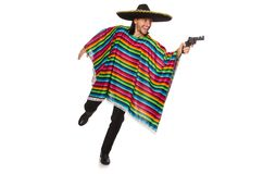 Handsome man in vivid poncho holding gun isolated Stock Photo