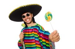 Handsome man in vivid poncho holding lollypop. Isolated on the white Stock Image