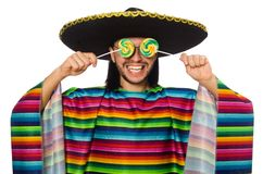 Handsome man in vivid poncho holding lollypop Stock Images
