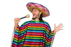 Handsome man in vivid poncho holding maracas Stock Image