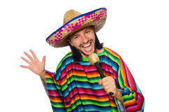 Handsome man in vivid poncho holding maracas Stock Photography