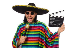 Handsome man in vivid poncho holding maracas Stock Photos