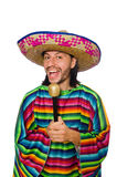 Handsome man in vivid poncho holding maracas Stock Photo