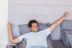 Handsome man waking up and stretching Royalty Free Stock Image