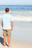 Handsome man walking on the beach Royalty Free Stock Image