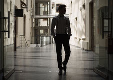 Handsome man walking in the building stock photo