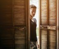 Handsome man walking in doors Stock Image