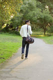 Handsome man walking in the park Stock Photo