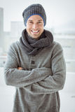 Handsome man in warm clothing smiling at camera Royalty Free Stock Image