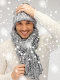 Handsome man in warm sweater, hat and scarf Stock Images