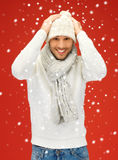 Handsome man in warm sweater, hat and scarf Stock Photography