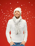 Handsome man in warm sweater, hat and scarf Royalty Free Stock Images