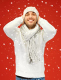 Handsome man in warm sweater, hat and scarf Stock Photo