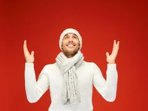 Handsome man in warm sweater, hat and scarf Royalty Free Stock Photos