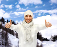 Handsome man in warm sweater, hat and scarf Royalty Free Stock Photography