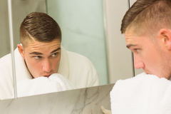 Handsome man washing his face Royalty Free Stock Photos