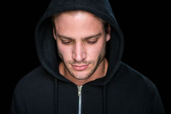 Handsome man wearing a black hoodie Stock Images