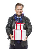 Handsome Man Wearing Black Leather Jacket Holding Christmas Gifts on Whit. Handsome Man Wearing Black Leather Jacket and Holiday Scarf Holding Christmas Gifts Stock Image