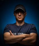 Handsome man wearing a cap on a blue Royalty Free Stock Photo