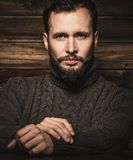 Handsome man wearing cardigan Stock Photography