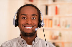 Handsome man wearing casual clothes and headset with microphone, great positive attitude smiling to camera Royalty Free Stock Photography
