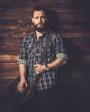 Handsome man wearing checkered  shirt. Man with wearing checkered  shirt and messenger bag Royalty Free Stock Image