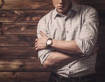 Handsome man wearing checkered  shirt in wooden house interior Royalty Free Stock Images