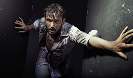 Handsome man wearing dirty clothes Royalty Free Stock Photography