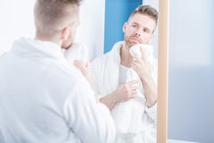 Handsome man wearing dressing gown Stock Photos