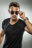 Handsome man wearing fashion sunglasses, looking at you Stock Photos