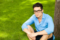Handsome man wearing glasses standing on the grass Royalty Free Stock Images