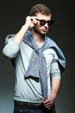 Handsome man wearing jeans, shirt and sunglasses Royalty Free Stock Image