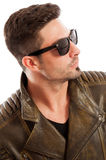 Handsome man wearing leather jacket and sunglasses Royalty Free Stock Images