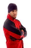 Handsome man wearing red winter jacket. On an isolated white background Royalty Free Stock Photography