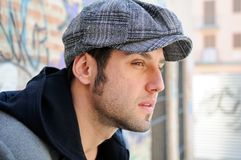 Handsome man wearing a retro cap Stock Photo
