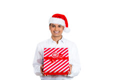 Handsome man wearing Santa hat and holding a present Royalty Free Stock Photo