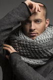 Handsome man wearing scarf. Portrait of a young man wearinh a scarf Stock Images