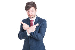 Handsome man wearing suit making fingers crossed with both hands Stock Photo
