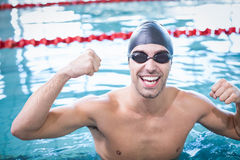 Handsome man wearing swim cap and goggles. At the pool Stock Image