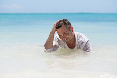 Handsome man in wet shirt Royalty Free Stock Image