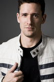 Handsome man in white leather jacket. Royalty Free Stock Image